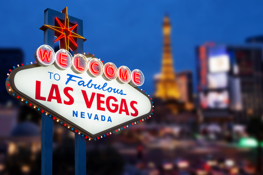 LAS VEGAS - MAY 12 : Welcome to fabulous Las Vegas neon sign with Las Vegas strip road background View of the strip on May 12, 2015